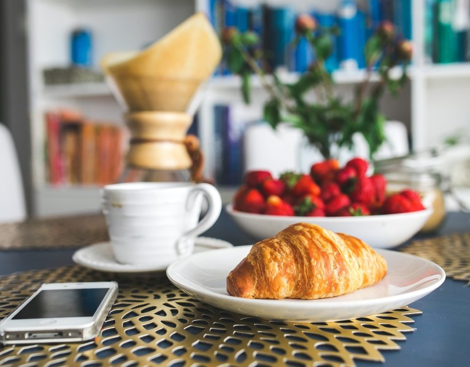 breakfast at home with croissant and coffee