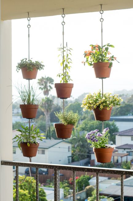 balcony with hanging flower pots