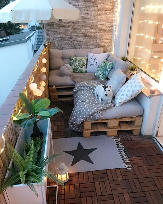 balcony with sofa and pillows