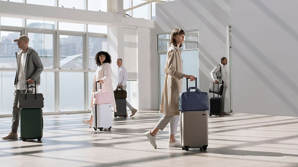people with suitcases at an airport