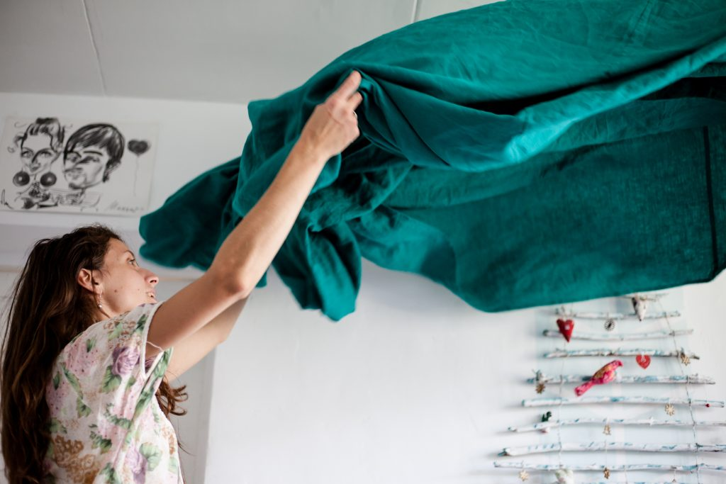 Woman putting on bedsheets