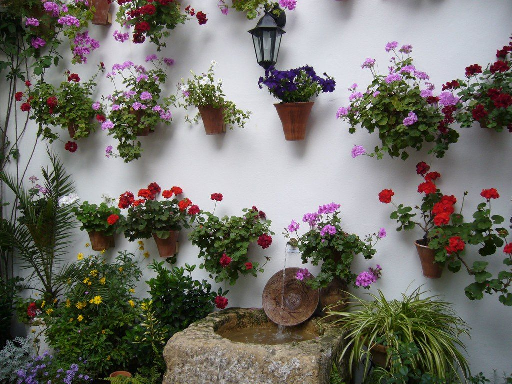 Practical and fine - flower pots on a white wall