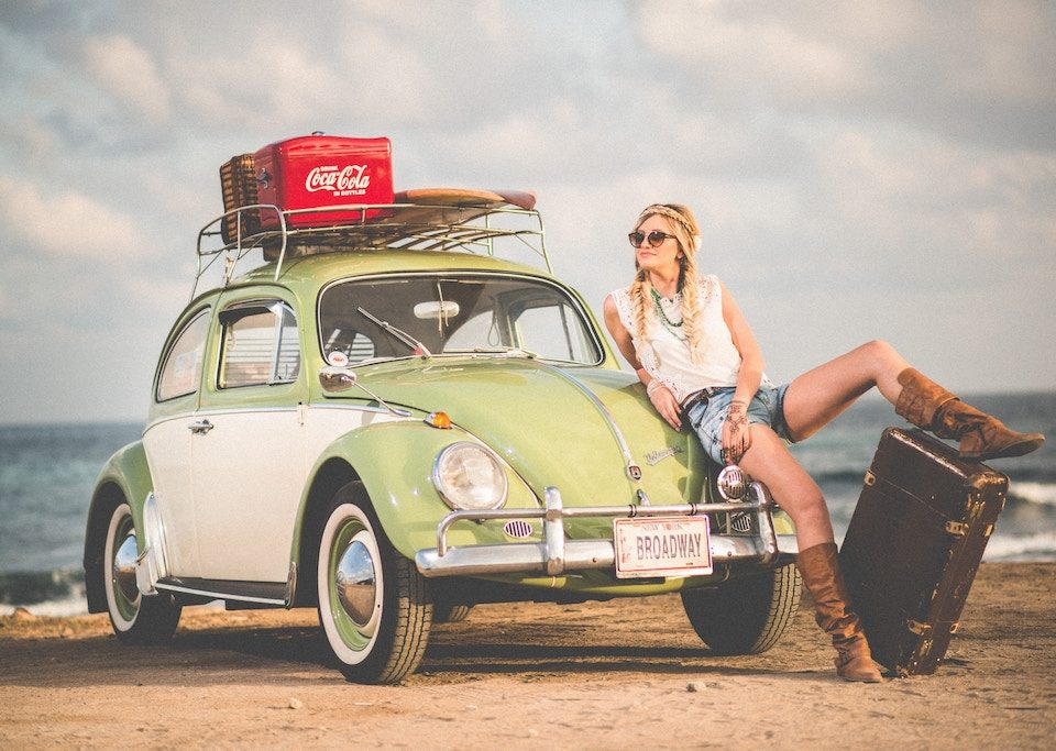 Woman traveling with a Beetle car - Nahariyya Israel
