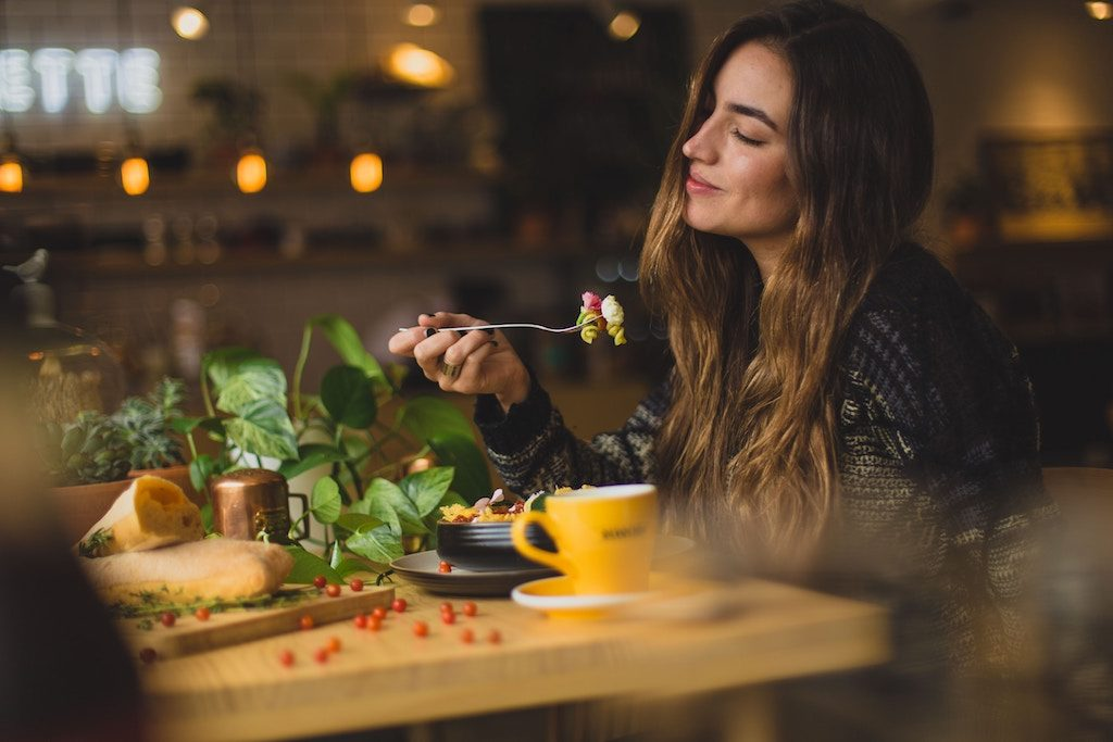 foodie woman enjoying eating her food