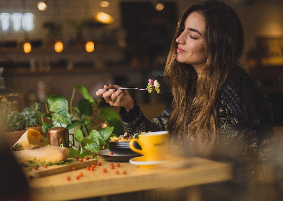 foodie woman enjoying eating her food