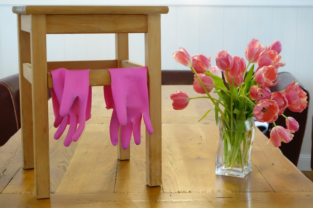 odor eliminator cleaning rubber gloves and tulips in a vase
