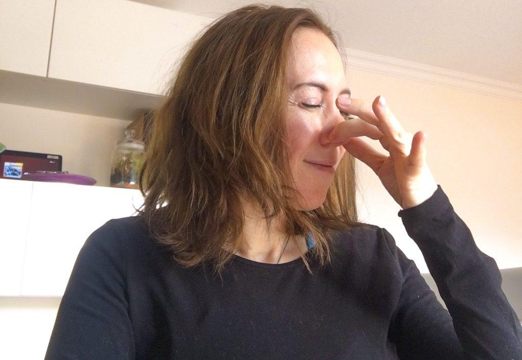 woman pinching her nose