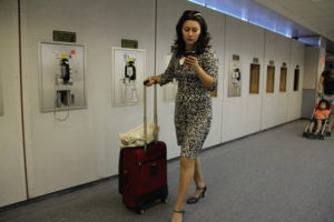 woman business traveller with a suitcase