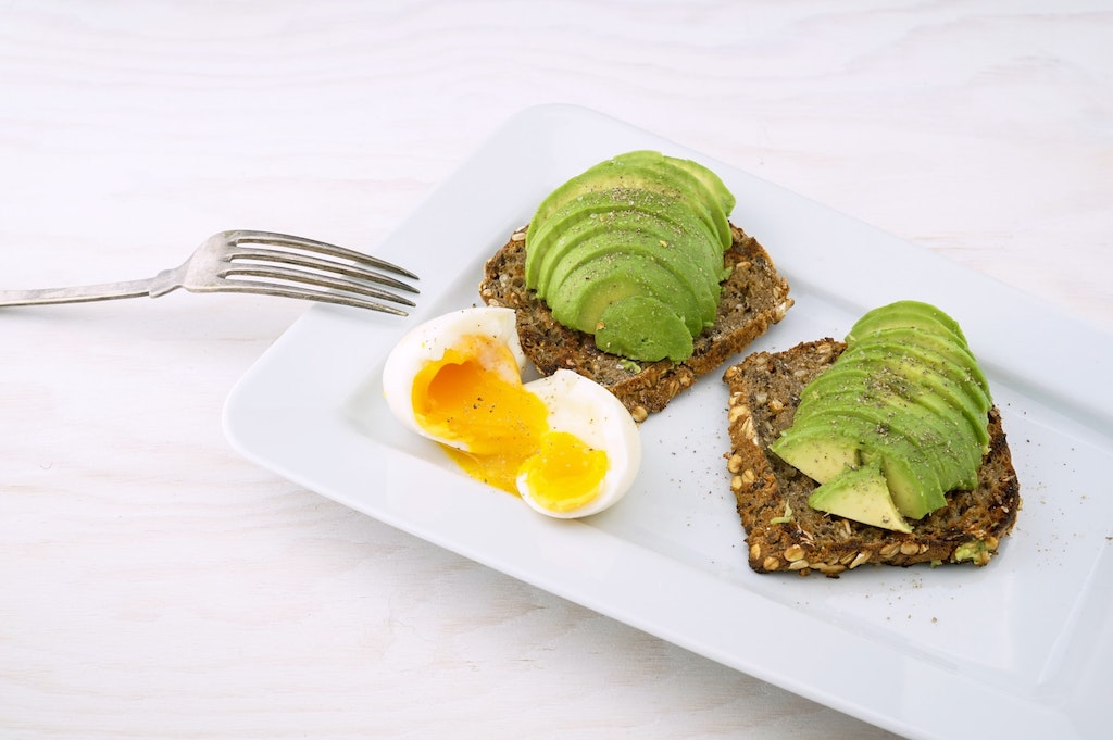 healthy breakfast - avocado on toast with boiled egg
