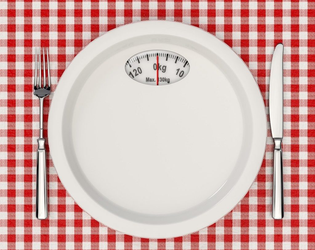 intermittent fasting and diet - plate and scales