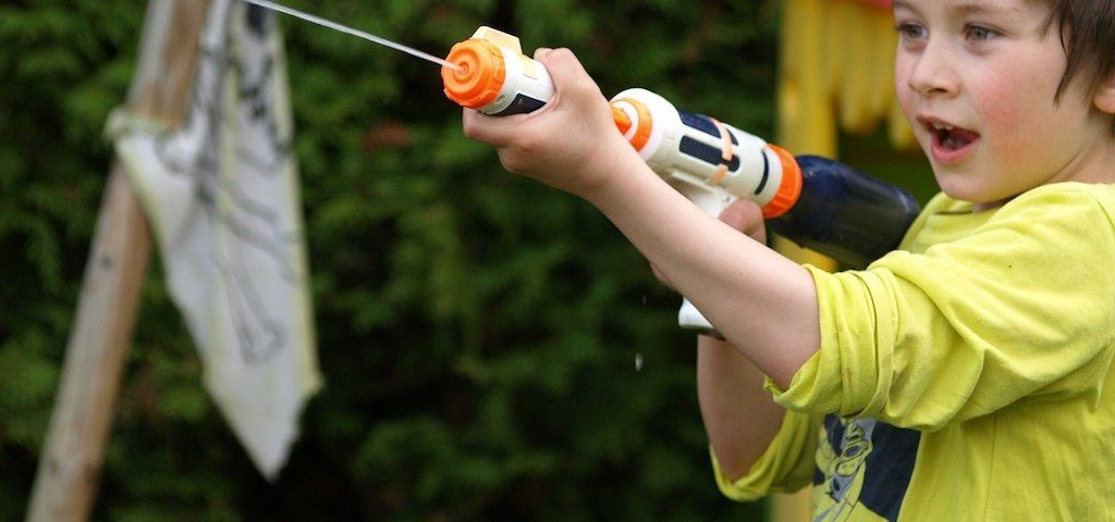 boy playing with a water gun