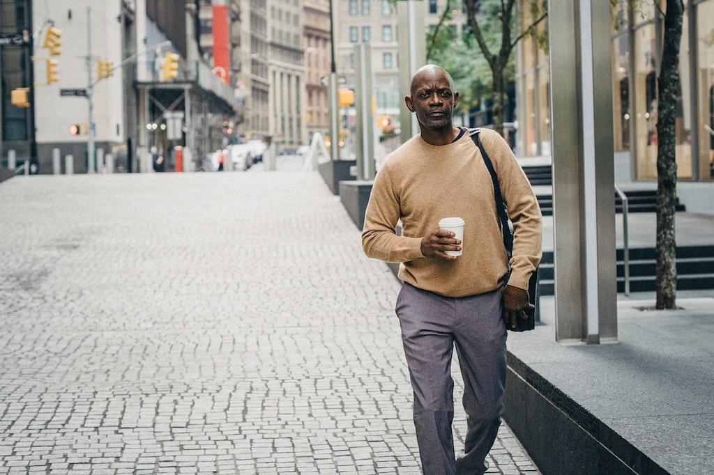 the fake commute - man walking with a coffee cup